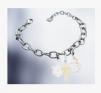 Swarovski: Buy 3 Charms and Get A Free Bracelet